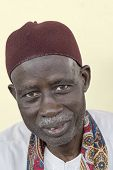 THIAROYE, SENEGAL, AFRICA - JULY 18, 2014 - Unidentified Muslim man sitting in his home