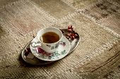 Cup Of Tea On Vintage Carpet
