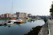Sunny summer weather on summer day at Weymouth North Quay marina and harbour Dorset coast