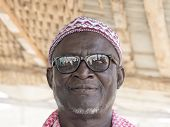 THIAROYE, SENEGAL, AFRICA - JULY 18, 2014 - Unidentified Muslim man entering the Grand Mosque