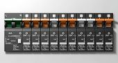 image of busbar  - A row of switched on household electrical circuit breakers on a wall panel - JPG