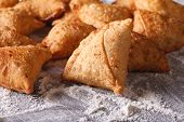 foto of samosa  - A pile of baking samosas on a floured table - JPG