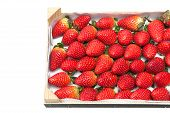 Ripe Strawberries In A Wooden Box On A White Background