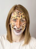 picture of face painting  - Young blond slav girl with face painting panther - JPG