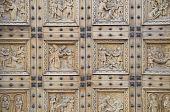 Wooden portal of St. Croce Church. Bastia Umbra. Umbria.