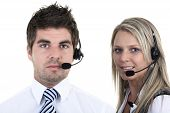 picture of receptionist  - Two receptionist working with a headset over white background. ** Note: Soft Focus at 100%, best at smaller sizes - JPG