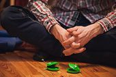 Pair Of Green Castanets Infront  Men