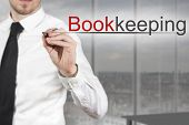 Businessman Writing Bookkeeping In The Air