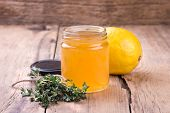 Lemon Jam In Glass Jar And Lemon On Rustic Wooden Board