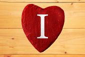I love red heart with wooden background