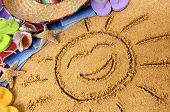 pic of mexican fiesta  - Smiling sun drawn in sand on a Mexican beach with sombrero straw hat - JPG