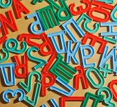 cyrillic alphabet letters on yellow paper background