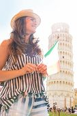 Young Woman With Italian Flag In Front Of Leaning Tower Of Pisa, Tuscany, Italy