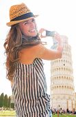 Happy Young Woman Taking Photo Of Leaning Tower Of Pisa, Tuscany, Italy