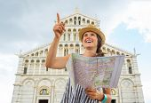 Happy Young Woman With Map Pointing In Front Of Duomo Di Pisa, P