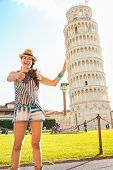 Funny Young Woman Supporting Leaning Tower Of Pisa And Showing T