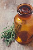 Pharmacy Bottle And Thyme Herb