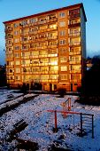 A Type Of House, Block Of Flats, In Beautiful Morning Light In Winter Snowy Land