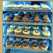 Assorted Cupcakes And Desserts  On The Bakery Storefront