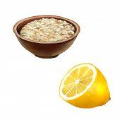 Bowl of oats porridge. Healthy breakfast, half of a lemon isolated on a white background