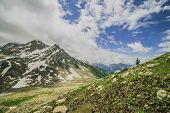 image of snow clouds  - snow mountain with green field and cloud - JPG