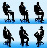 Silhouettes of businessmen in office chairs