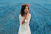 Beautiful Woman Resting On Summer Meadow