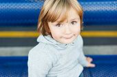 Close up portrait of adorable toddler boy