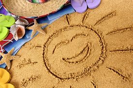 picture of starfish  - Smiling sun drawn in sand on a Mexican beach with sombrero straw hat - JPG