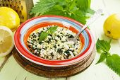 image of nettle  - Risotto with nettles and lemon in the ceramic plate - JPG