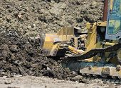 picture of caterpillar  - Close up of bulldozer caterpillar moving earth at construction site - JPG