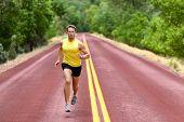 stock photo of sprinter  - Running man runner sprinting for fitness and health - JPG