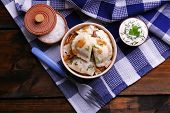 foto of liver fry  - Tasty dumplings with fried onion in brown bowl - JPG