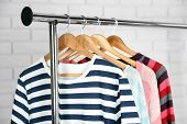picture of clothes hanger  - Different clothes on hangers close up - JPG