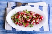foto of sesame seed  - Salad from a radish with sesame seeds in a white plate - JPG