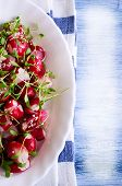 image of sesame seed  - Salad from a radish with sesame seeds in a white plate - JPG