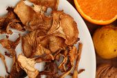 picture of chanterelle mushroom  - Dried mushroom chanterelle on the white plate - JPG