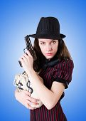stock photo of handgun  - Woman gangster with handgun against the gradient - JPG