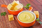 foto of shredded cheese  - cheese sauce in bowl and on a table - JPG