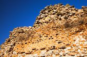 stock photo of fortified wall  - part of the destroyed wall from a fortress - JPG