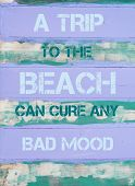 picture of mood  - Concept image of A TRIP TO THE BEACH CAN CURE ANY BAD MOOD motivational quote written on vintage painted wooden wall - JPG
