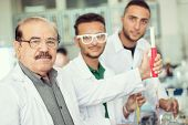 foto of conduction  - Group of scientists conducting research in a lab environment - JPG