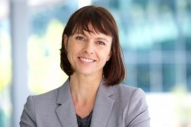 image of stand up  - Close up portrait of a professional business woman smiling outdoor - JPG
