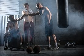 picture of box-end  - Rest three guys who have completed a complex crossfit workout in the gym - JPG