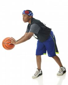 pic of tween  - A tween African American athlete ready to pass a basketball - JPG