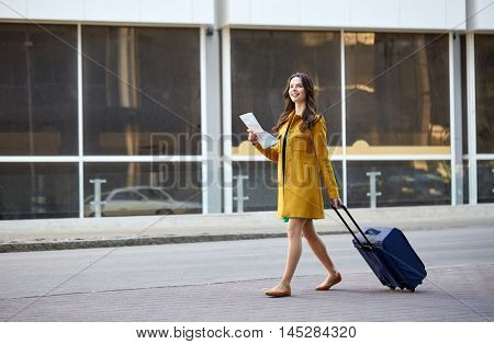 poster of travel, trip, tourism, people and vacation concept - happy young woman with carry-on travel bag and