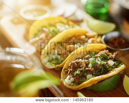 three types of mexican street tacos with barbacoa, carnitas and Chicharr�³n, shot with lens fla