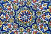 Detail of a typical colorful decoration of a ceramic plate of Seville - Spain.