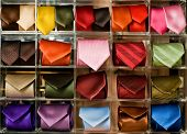 Shelf full of fine silk neckties in a Italian textile store