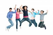 Happy active group of young friends jump together with fun isolated on white background